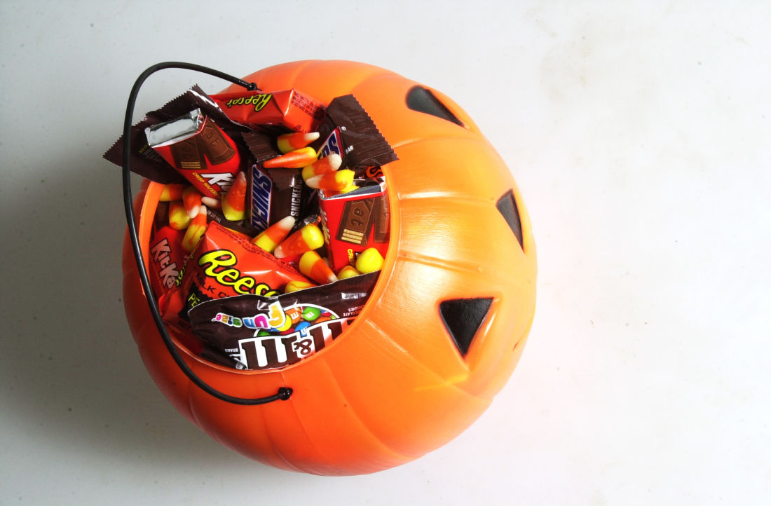 the real story behind why we eat candy on halloween first we feast the real story behind why we eat candy on halloween